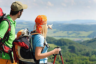 young-backpack-couple-with-hiking-poles.jpg