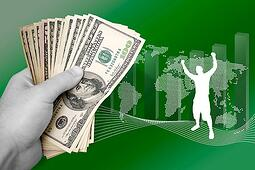 a-montage-about-profit-in-world-business-a-successful-man-throws-his-arms-up-in-achievement_low