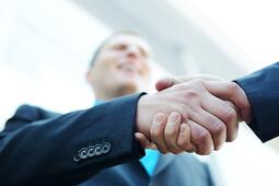 business-shaking-hands-in-front-of-modern-building-with-copy-space-selective-focus_BFQDWQ0Vj