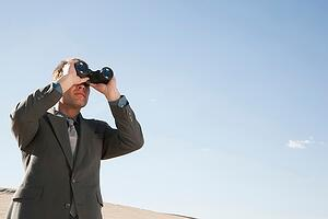 businessman-with-binoculars__low