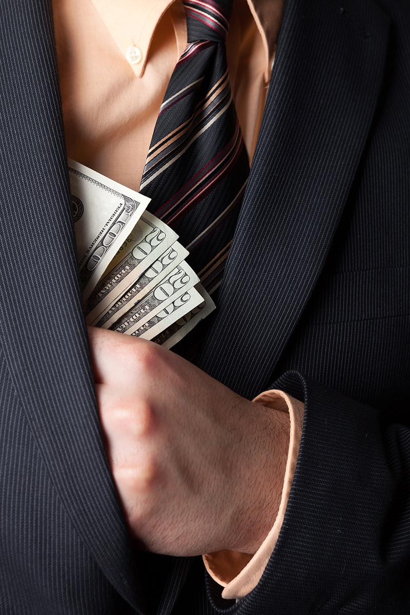 close-up-of-a-business-mans-hand_low Corruption.jpg