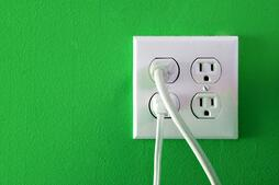 electrical-outlets-with-four-spaces-and-two-of-them-have-chords-plugged-in_BFrt-uCBsGREEN