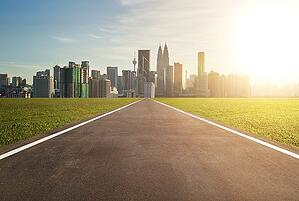 graphicstock-asphalt-road-leading-to-a-city_low