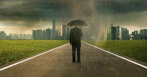 graphicstock-businessman-below-storm-rain-with-umbrella_LOW-1
