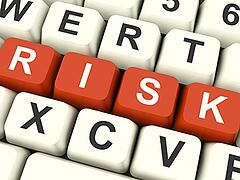 risk-computer-keys-showing-peril-and-uncertainty_low